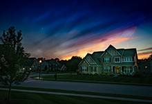 Picture of sky and house at night.