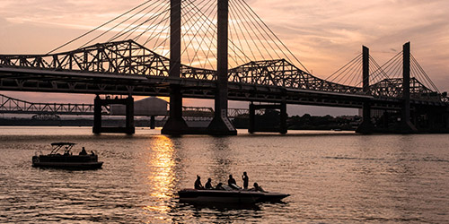 People on boats in the Ohio River.