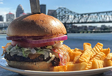 Burger and fries with Ohio River in background.